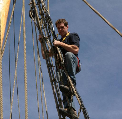 Dan Snow climbing the rigging on a reconstruction of a Tudor ship.