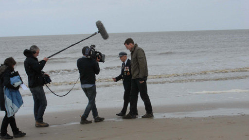Dan with veteran on the beach