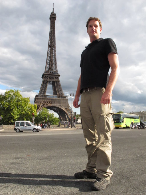 Dan Snow standing in front of the Eiffel Tower