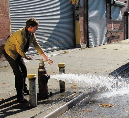Dan turning a tap